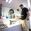 Box Office Manager Dana McLaughlin Jr. looks at glass marbles for sale at the newly expanded Gallery Store at the Strand Center for the Arts in Plattsburgh. The renovations include an expanded layout and more shelving to display artists' items. The new gallery store will be unveiled during a grand opening on Saturday, Dec. 3, from 10 a.m. through the Holiday Parade and tree-lighting events taking place that day.<br /> KAYLA BREEN/ STAFF PHOTO