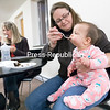 Eight-month-old Isabella Hulkow of Peru savors a bite of cake fed to her by her mom, Samantha, during the grand opening of the Nature's Way Baby Cafe in the House of Prayer at 63 Broad St. in Plattsburgh. Formerly Nature's Way Mother's Cafe, the concept was developed by Champlain Valley Physician's Hospital Alice T. Miner Women and Children's Center, the Clinton County Health Department and Behavioral Health Services North with grant funding through the New York State Department of Health as a drop-in breastfeeding site that provides a place for moms with nursing babies to connect with others and receive support and instructions from lactation specialists. The Baby Cafe — the first in the region — is a part of the nonprofit Baby Cafe USA, a national initiative to provide free, evidence-based lactation and support. The cafe is open the second Tuesday and fourth Thursday of each month. For more information, including hours of operation, call 518-562-7532.<br /> GABE DICKENS/ P-R PHOTO