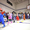 Dressed as pirates, witches and the video game character Mario, Colleen Pandolph's kindergarten class waves to parents and teachers as they march around the gym during the annual Halloween Parade at Cumberland Head Elementary School Tuesday. Students and teachers were encouraged to dress up for the event.<br /> KAYLA BREEN/ STAFF PHOTO