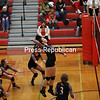 Beekmantown's Kaitlyn Bjelko (17) goes up for a kill during a NYSPHSAA Class B volleyball regional Saturday at Saranac Central School.<br /> KAYLA BREEN/ STAFF PHOTO