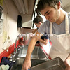 Jonathan Grald, 16, (right) and Carson LaBarre, 14, scrub and rinse dishes inside the Salvation Army kitchen as part of their family Thanksgiving scavenger hunt. Other family members joined in and helped serve food and clean tables.<br /> KAYLA BREEN/ STAFF PHOTO