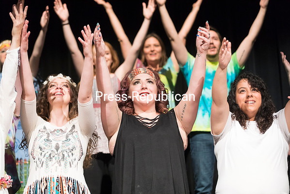 """For the finale of the musical """"Wild Thing: A 1960's Tribute"""" at Clinton Community College's Stafford Theater, Clinton Community College Drama Club members perform the song """"Aquarius/Let the Sunshine In"""" from the hit rock musical """"Hair."""" The number at the recent production concluded with cast members dancing with the audience and handing out plastic flowers. """"Wild Thing"""" featured direction and choreography by Jackie Robertin and music direction by Kaela Homburger.<br /> GABE DICKENS/ P-R PHOTO"""