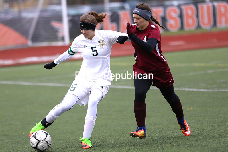Northern Adirondack's Katee Brothers (5) attempts to keep the ball in play as Stillwater's Cassidy Sheehan (4) applies defensive pressure during a NYSPHSAA Class C girls soccer regional final Saturday at Plattsburgh High.<br /> KAYLA BREEN/ STAFF PHOTO