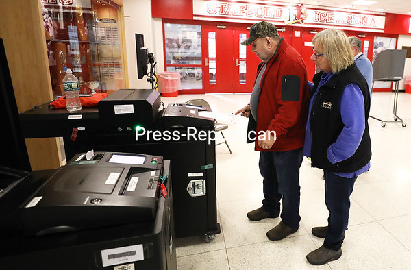 Jim and Mary-Ellen Cleveland feed a ballot into the ballot machine at the City of Plattsburgh Ward 3 polling station at the SUNY Plattsburgh Field House. No candidates were on the ballot in the city, but voters weighed in on the three statewide propositions. KAYLA BREEN/ STAFF PHOTO