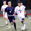 Lake Placid's Jarell Paul (9) looks to dribble up the field, with St. Lawrence's Noah Rijnders (6) by his side, during a NYSPHSAA Class C boys soccer regional semifinal Wednesday at Plattsburgh High.<br /> KAYLA BREEN/ STAFF PHOTO