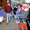 Matt Ryan (right) and his daughter Unna, 3, of Saranac Lake sight up their next trick-or-treat stop as they amble down Main Street in Saranac Lake on Tuesday. Despite light snow showers, hundreds of Halloween fun-lovers crowded the village's downtown. Main Street was closed to traffic in the afternoon for the trick-or-treaters to walk about safely.<br /> JACK LADUKE/ P-R PHOTO