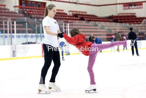 Plattsburgh resident Meghan Germain helps 8-year-old Nora Mesec of Peru with her form during a recent open skate session at the Plattsburgh State Field House in Plattsburgh. Both are members of the Skating Club of the Adirondacks, taking advantage of the ice time to practice. Open skate is also scheduled for 1:30 to 2:45 p.m. Nov. 12 and 24, and Dec. 26 through 29. Admission is $3 for the public and $2 for those with a SUNY Plattsburgh ID. Skate rentals are extra and available for the same fees. GABE DICKENS/ P-R PHOTO