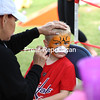 Brayden Gadwaw, 5, gets his face painted as a tiger by Face Designs by Sam before going to feed the goats and pick out pumpkins Saturday at Banker Orchards in Plattsburgh.<br /> KAYLA BREEN/ STAFF PHOTO