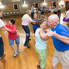 """Veterans and newcomers alike perform a square dance routine during a free Fun Night, hosted recently by the North Country Squares Dance Club, at their building on the Clinton Country Fairgrounds in Morrisonville. The club will be hosting introductory """"Mainstream"""" lessons, taught by longtime caller Bob LaBounty, every Wednesday and Thursday from 7 p.m. to 9 p.m. for $10 a week. Individual dancers and couples are welcome. For more information, including specifics on plus-level and advanced dances, visit their Facebook page at facebook.com/northcountrysquares.<br /> GABE DICKENS/ P-R PHOTO"""
