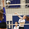 Peru's Olivia Bousquet (5) attempts to block a hit by Plattsburgh's Grace McMahon (8) during a Champlain Valley Athletic Conference volleyball match Tuesday in Peru.<br /> KAYLA BREEN/ STAFF PHOTO