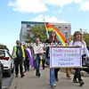 Members of the Adirondack North Country Gender Alliance lead community pride supporters down court street toward SUNY Plattsburgh during the LGBTQ Pride Parade in downtown Plattsburgh.<br /> KAYLA BREEN/ STAFF PHOTO