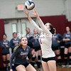 Northeastern Clinton's Nathalie Jubert sets the ball during Monday's Champlain Valley Athletic Conference match against AuSable Valley at Northeastern Clinton Central School.<br /> GABE DICKENS/ P-R PHOTO
