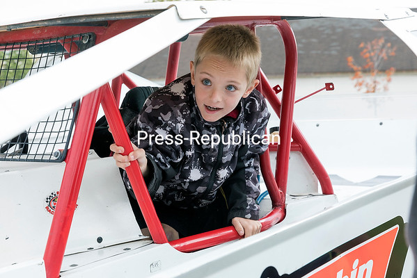 During a visit to the Champlain Valley Transportation Museum in Plattsburgh, Anthony Reynolds-Corrie, 7, from Lewis, explores the interior of a DIRTcar Modified vehicle. As fun as that was, the highlight of the day was finding out that his desire to attend a Formula 1 race was being granted by Make-A-Wish Northeast New York. GABE DICKENS/P-R PHOTO
