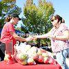 Anne Nichols (right) takes a break from visiting her daughter at college to buy some sweet tango apples from Chazy Orchards' Teri Frederick during the recent SUNY Plattsburgh On Campus Farmers Market in Angell College Center's Amite Plaza. The market featured goods from Bucksberry Farm, Fledging Crow, the North Country Food Co-op and the SUNY Plattsburgh Student Campus Garden.<br /> KAYLA BREEN/ STAFF PHOTO