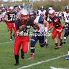 Beekmantown's Cris Arzola (23) rushes up the field as AuSable Valley's Tyler Atkins (32) and Emerson Snow (33) chase from behind during Champlain Valley Athletic Conference football Saturday in Beekmantown.<br /> KAYLA BREEN/ STAFF PHOTO