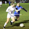 Northeastern Clinton's Marlie Sample (13) dribbles the ball past Peru's Allie Beatie (22) during a Section VII Class B girls soccer quarterfinal Tuesday in Champlain.<br /> KAYLA BREEN/ STAFF PHOTO