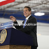 Gov. Andrew Cuomo announces in front of a packed crowd that Norsk Titanium will be producing aerospace components for Boeing and Spirit Aerosystems during a special dedication ceremony at Norsk Titanium in Plattsburgh.<br /> KAYLA BREEN/ STAFF PHOTO