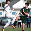 Seton Catholic's Kaymani Grashin collides with Elizabethtown-Lewis/Westport's Will Napper while going for a loose ball during boys Northern Soccer League action Monday in Plattsburgh.<br /> GABE DICKENS/ P-R PHOTO