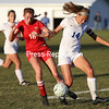 Saranac Lake's Kylee Clark (16) and Peru's Allison Post (14) battle for possession of the ball during girls Northern Soccer League action Tuesday in Peru.<br /> KAYLA BREEN/ STAFF PHOTO