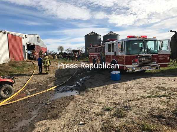 Firefighters work outside the heifer barn at the Leduc Green Acres farm in Champlain during a fire there Monday morning.<br /> BOB BENNETT/ STAFF PHOTO