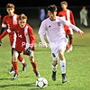 Northeastern Clinton's Kobe LaRoche (8) dribbles the ball down the field, while Saranac's Brexton Montville (14) chases from behind during boys Northern Soccer League play Wednesday in Champlain.<br /> KAYLA BREEN/ STAFF PHOTO