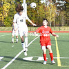 Chazy's Hunter Bechard (10) comes down to the ground after heading the ball forward as Willsboro's Warren Jackson defends during a Section VII Class D boys soccer championship Saturday at Plattsburgh High.<br /> JOEY LAFRANCA/ STAFF PHOTO