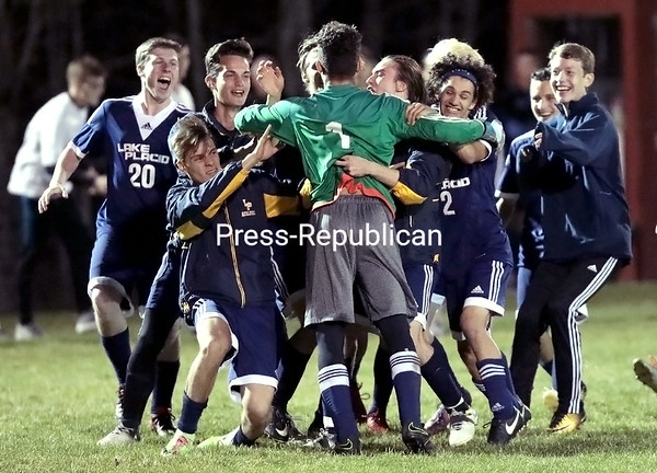 After going scoreless through double overtime, Lake Placid players mob their goaltender, Jacob Novick, after he made two penalty-kick saves against Seton Catholic, which helped propel the Blue Bombers to a win. GABE DICKENS/ P-R PHOTO