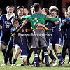 After going scoreless through double overtime, Lake Placid players mob their goaltender, Jacob Novick, after he made two penalty-kick saves against Seton Catholic, which helped propel the Blue Bombers to a win.<br /> GABE DICKENS/ P-R PHOTO
