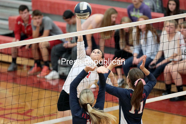 Saranac's Nikki Donah goes up to spike the ball during Thursday's Champlain Valley Athletic Conference match against AuSable Valley in Saranac.<br /> GABE DICKENS/ P-R PHOTO