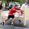 Members of the SUNY Plattsburgh men's lacrosse team take part in the Plattsburgh Noon Rotary Bed Races in front of City Hall Saturday morning. The team, sponsored by Lake Champlain Roofing, won first place in the competition.<br /> GABE DICKENS/ P-R PHOTO
