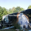The forest behind the home at 112 Recore Road can be seen through holes burnt into the structure by a house fire Saturday morning. Along with the fire, smoke caused extensive damage throughout the home.<br /> KAYLA BREEN/ STAFF PHOTO