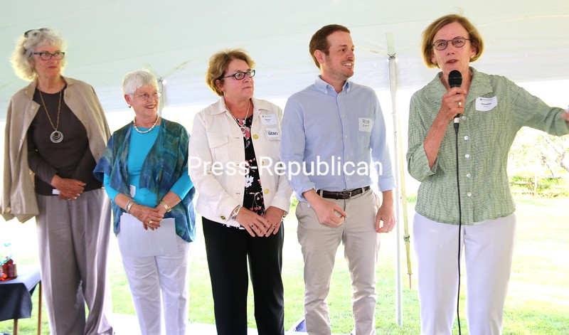 Meredith Prime (from right) addresses those gathered for the Adirondack Foundation's recent 20th anniversary celebration while Rob Carr, Donna Beal, Elise Widlund and Harriet Barlow wait their turns to speak.<br /> ALVIN REINER/ P-R PHOTO