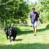 Julian Breyette and his two black german shepherds Blue (left) and Duke enjoy a sunny stroll through the trails on Cumberland Head.<br /> KAYLA BREEN/ STAFF PHOTO