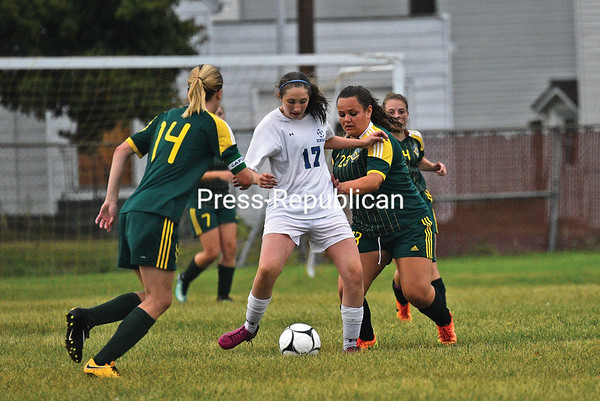 Seton Catholic's Gillian Boule (17) looks to keep possession of the ball while Northern Adirondack's Avery Brother (14) and Kira Labarge (23) apply defensive pressure during a Northern Soccer League Division II match Tuesday in Plattsburgh.<br /> KAYLA BREEN/ STAFF PHOTO