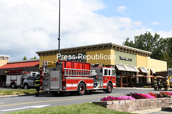 "An automatic fire alarm at Panera Bread in Consumer Square prompted response from Town of Plattsburgh District 3, Morrisonville, South Plattsburgh and City of Plattsburgh fire departments and Clinton County Deputy Fire Coordinator Mike Cahoon at 10:46 a.m. Thursday. ""They had a light smoke condition inside the building,"" District 3 Fire Chief R. Scott Ewing said. Crews conducted a thorough sweep of the building's interior and exterior but found no active fire. They believe the smoke originated in the grill area, Ewing said, though the exact cause is unknown. The smoke dissipated as the departments investigated. Ewing commended Panera's management for evacuating the restaurant and making sure all employees were accounted for. All crews were back in service around 11:30 a.m.<br /> KAYLA BREEN/ STAFF PHOTO"