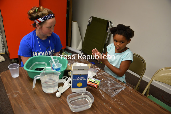 Volunteer Meghan Sorrell assists 8-year-old Kaysha Korth with a science project at the recent Vacation Bible School at the Peru Fellowship Center. The week-long event was open to ages 3 to 12 and involved religion, crafts, recreation, music and science. Seventy volunteers were on hand to give help to 126 children. The fun week was sponsored by Peru Community Church and St. Augustine's Church. JOANNE KENNEDY/ P-R PHOTO