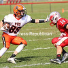 Plattsburgh High's Zack Bieber (88) looks to get past Beekmantown's Dominick Bordeau (14) during Champlain Valley Athletic Conference football Saturday in Beekmantown.<br /> KAYLA BREEN/ STAFF PHOTO