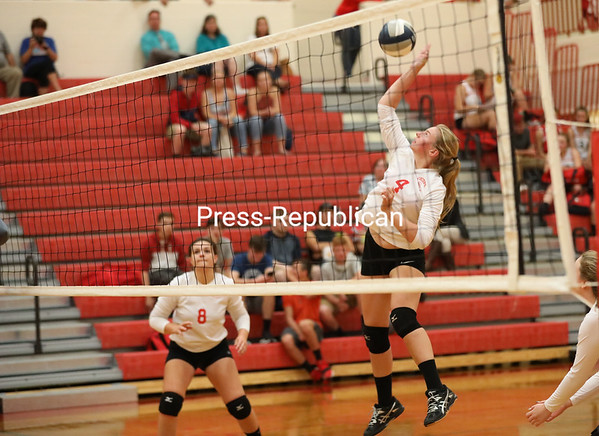 Saranac's Maddie Hoeth (4) goes up to send the ball over the net during Tuesday's Champlain Valley Athletic Conference volleyball match against Northeastern Clinton at Saranac Central School. KAYLA BREEN/ STAFF PHOTO