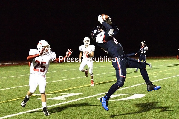 AuSable Valley's Matthew Pray hauls in a 20-yard catch during Friday's Champlain Valley Athletic Conference football game against Saranac Lake. The Patriots won 38-30.<br /> KAYLA BREEN/ STAFF PHOTO