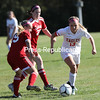 Beekmantown's Kirsten Villemaire (13) carries the ball upfield past Saranac's Taylor Alexander (22) and Kayla Myers (15) during Tuesday's Northern Soccer League match at Beekmantown Central School.<br /> KAYLA BREEN/ STAFF PHOTO