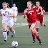 Saranac's Bella LaCroix (7) takes the ball down the field as Plattsburgh High's Sophie Gottschall (7) chases from behind during girls Northern Soccer League play Tuesday at Plattsburgh High.<br /> KAYLA BREEN/ STAFF PHOTO