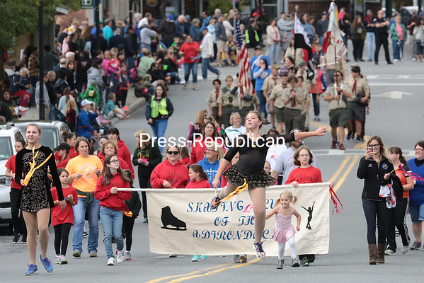 Members of the Skating Club of the Adirondacks make their way down Bridge Street in Plattsburgh Saturday afternoon as part of the 2017 Battle of Plattsburgh Commemoration parade. Grand marshals of the march were Stan and Chris Ransom, honored for their years of service to the commemoration. The 2017 festivities will conclude today with a reenactment of the Battle of Plattsburgh Bay at 1:30 p.m., visible from the Champlain Monument and Cumberland Avenue in Downtown Plattsburgh. See Page A3 for a schedule of other commemoration activities taking place today.<br /> GABE DICKENS/ P-R PHOTOS