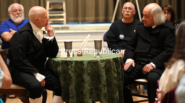 """Kyle Jenks, portraying President James Madison, and Ron Duquette, as Albert Gallatin, act out Scene 2 from the original stage play """"From Plattsburgh to the Peace"""" in the City Hall auditorium Sunday.<br /> KAYLA BREEN/ STAFF PHOTO"""