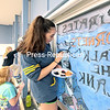 Peru Central School senior Jessica Sedgwick, along with classmate Cierra Van-Ness and her mother, Kathleen, paints a mural on the High School cafeteria windows as the senior class entry in the window-painting contest for grades 9 through 12 as part of Spirit Week. The week-long celebration wraps up today with the homecoming football game at 1:30 p.m., with the Peru Indians taking on the Plattsburgh Hornets.<br /> GABE DICKENS/ P-R PHOTO