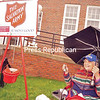 Ringing a bell by a Salvation Army red kettle, Shirley Hossler attracts donations for Texas and Florida hurricane victims from residents passing by the post office on Broadway in the Village of Saranac Lake. It was worth sitting there in the rain Friday, she said, as she collected about $1,000.<br /> JACK LADUKE/ P-R PHOTO