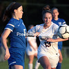 Northeastern Clinton's Marlie Sample attempts to intercept a ball intended for Peru's Mairead Lawliss during Thursday's Northern Soccer League match at Northeastern Clinton Central School.<br /> GABE DICKENS/ P-R PHOTO