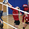 Saranac's Maddie Hoeth tips the ball back over the net as AuSable Valley's Erykah Siegrist attempts a block during Monday's Champlain Valley Athletic Conference volleyball match at AuSable Valley Central School.<br /> GABE DICKENS/ P-R PHOTO