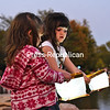 Alayna Kivlehan, 3 (left), and her sister, Kalyn, 5, prepare to float lanterns onto Hawkins Pond during SUNY Plattsburgh's CommUNITY Night @ the Pond. The event, organized by the Center for Community Engagement and the Student Association, celebrated unity, strength and togetherness with activities such as rock climbing, dance and art. <br /> KAYLA BREEN/ STAFF PHOTO