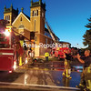 Firefighters put away hoses after knocking down a fire in the north tower of St. Patrick's Church in Rouses Point Saturday night.<br /> SUZANNE MOORE/ STAFF PHOTO