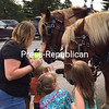 A group of kids greets a pair of Belgian horses from Country Dreams Farm at the U.S. Oval Sunday. The Plattsburgh farm offered wagon rides as part of the festivities for the 2017 Battle of Plattsburgh Commemoration.<br /> LOIS CLERMONT/ STAFF PHOTO